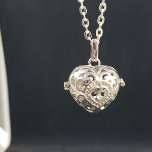 Jewelry - Heart shape silver tone cage pendant